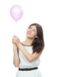 Young happy girl with pink balloon as a present for birthday