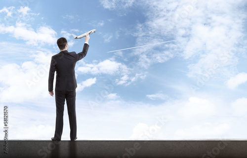 man holding airplane