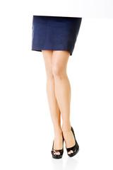 Woman's leg. Business woman. Shirt.