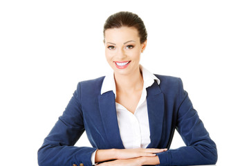 Attractive business woman sitting and smiling.