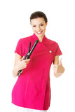Attractive beautiful woman/beautician holding hair straightener,