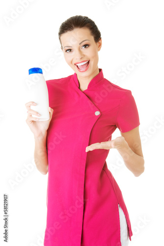 Attractive woman holdin body lotion.
