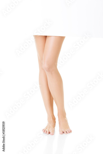 Female smooth legs. Closeup.