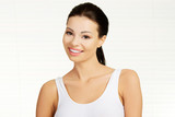 Attractive woman in tshirt smiling.