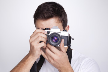 Photographer with camera against gray background
