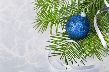 Christmas ball with fir-tree branches on abstract background