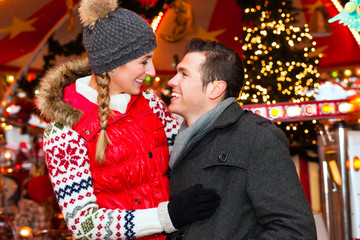 Couple during  the Christmas market or advent season
