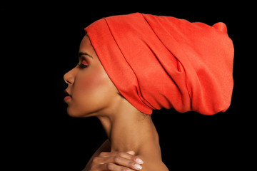 Attractive woman's profile in turban. Closed eyes.