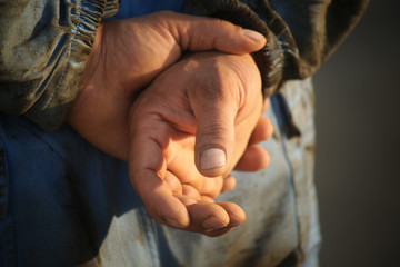 Hands of a worker on a oil field