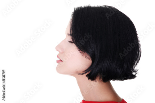 Profile of a woman with closed eyes. Side view.