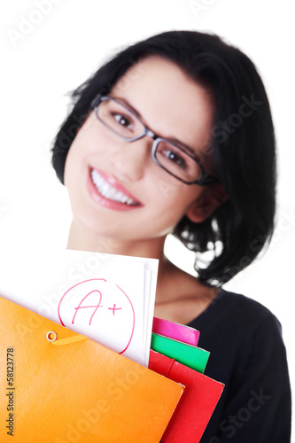 Casual young woman showing her perfect exam result.
