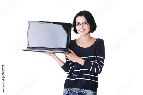 Attractive woman holding a laptop.