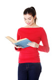 Attractive young woman holding open book,reading.