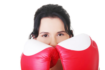 Attractive young woman with boxing gloves. Closeup.