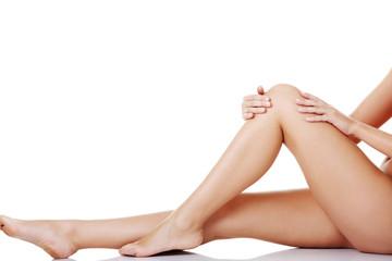 Bare female's legs. Horizontal view.