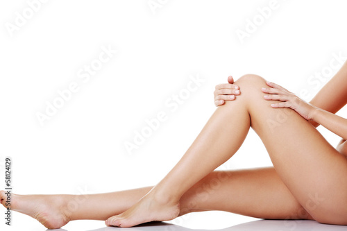 Bare female's legs. Horizontal view.