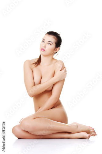 Beautiful sexy naked woman sitting.