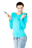 Attractive woman with two pens.