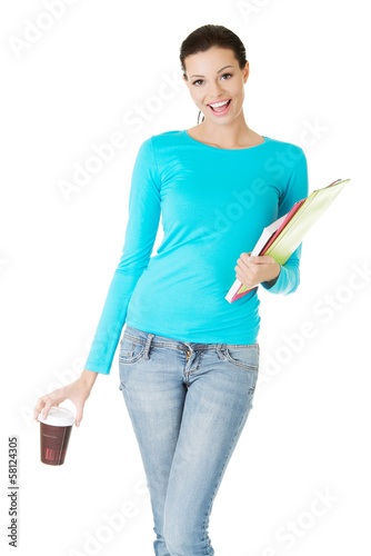 Attractive young woman with a cup and files.