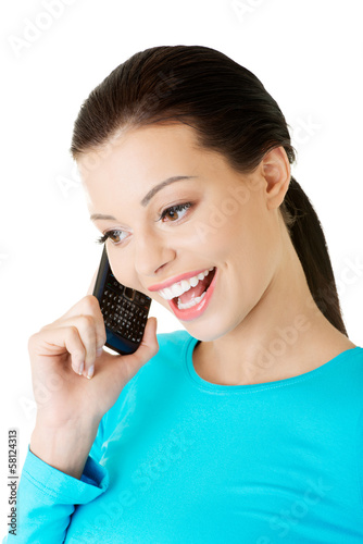 Attractive woman talking on phone.