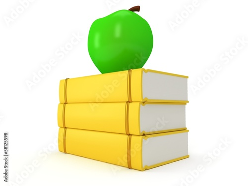 Yellow book tower with green apple