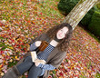 Teen Girl Relaxing Outdoors during the Autumn Season