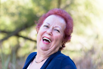 Enthusiastic Senior Woman Giving a Genuine Laugh