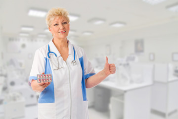 Mature doctor with pills