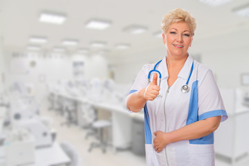 Mature doctor shows ok gesture