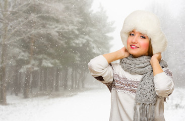 Young girl on snowy forest