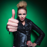 fashion womanin leather jacket making the ok thumbs up sign