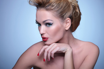 woman with nice make up and hairstyle looking away