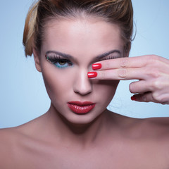 young beauty woman covering one eye with her fingers