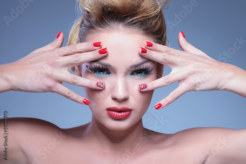 young beauty woman with hands framing her face and eyes