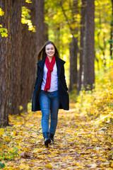 Teenage girl walking in city park