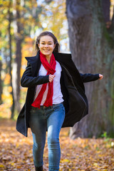 Teenage girl running in city park