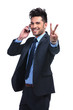 business man on the phone  making the victory sign