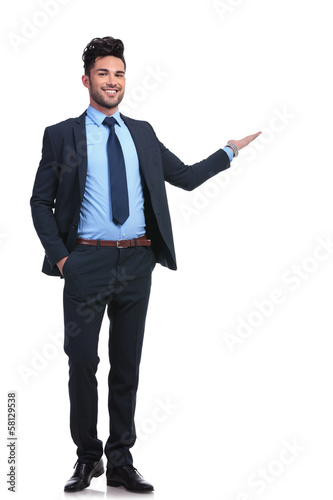 full body picture of a happy business man presenting