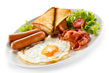 English breakfast - toast, egg, bacon and vegetables