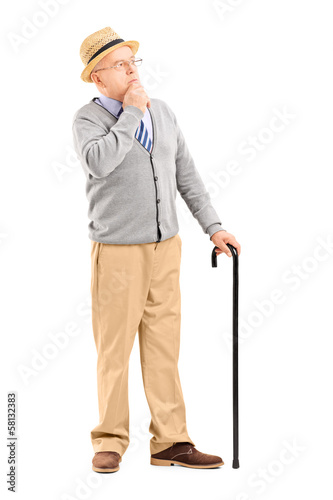Doubtful senior man with cane in thoughts