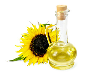 Vegetable oil in a carafe with a sunflower