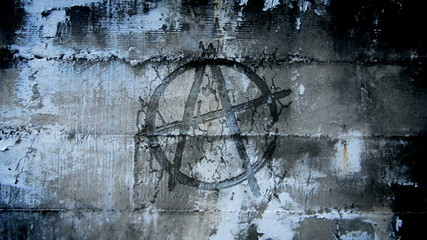 Anarchy symbol in urban wall