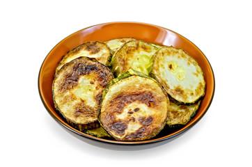 Zucchini fried in ceramic ware