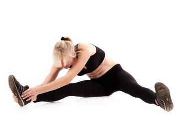beautiful woman doing stretching before exercise