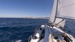 Sailing yacht on the race in blue sea
