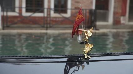 Gondola in Venice at the pier closeup view of figurine