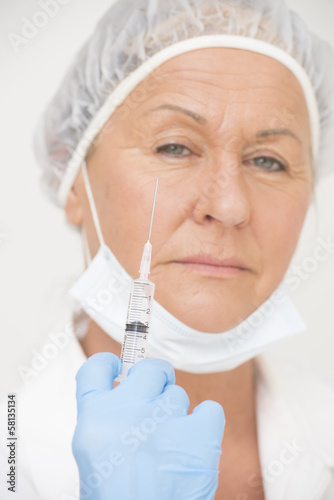 Female hospital nurse with syringe