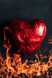 Burning heart on a black background