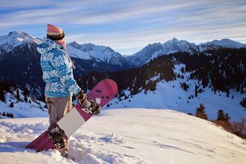 Sport woman in snowy mountains