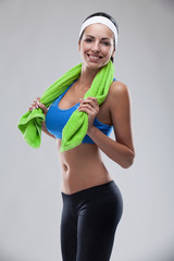 young smiling brunette woman after sportive exercise and holding